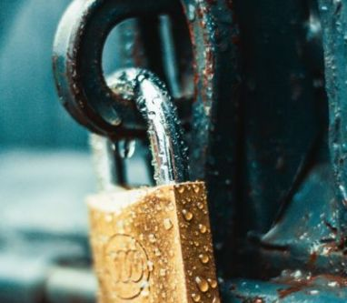 close-up-photography-of-wet-padlock-1068349