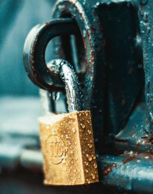 close-up-photography-of-wet-padlock-1068349